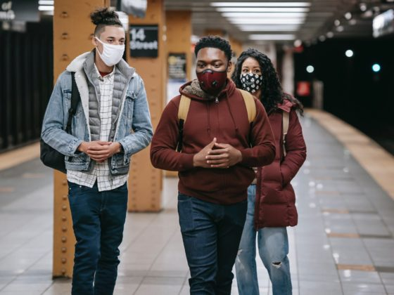 young multiethnic students in medical masks